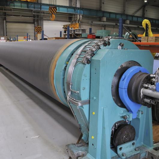 Reduce friction and increase roll reliability