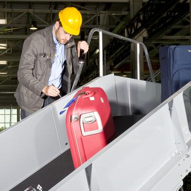 Engineer insecting baggage conveyor