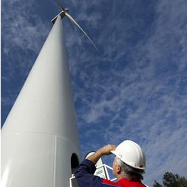 Engineer viewing a wind turbine