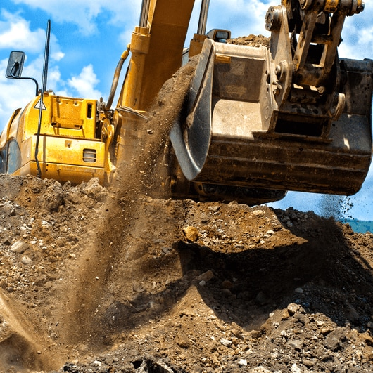 Progressive lubrication systems for construction machines