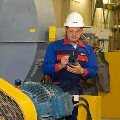 Operator inspecting machine