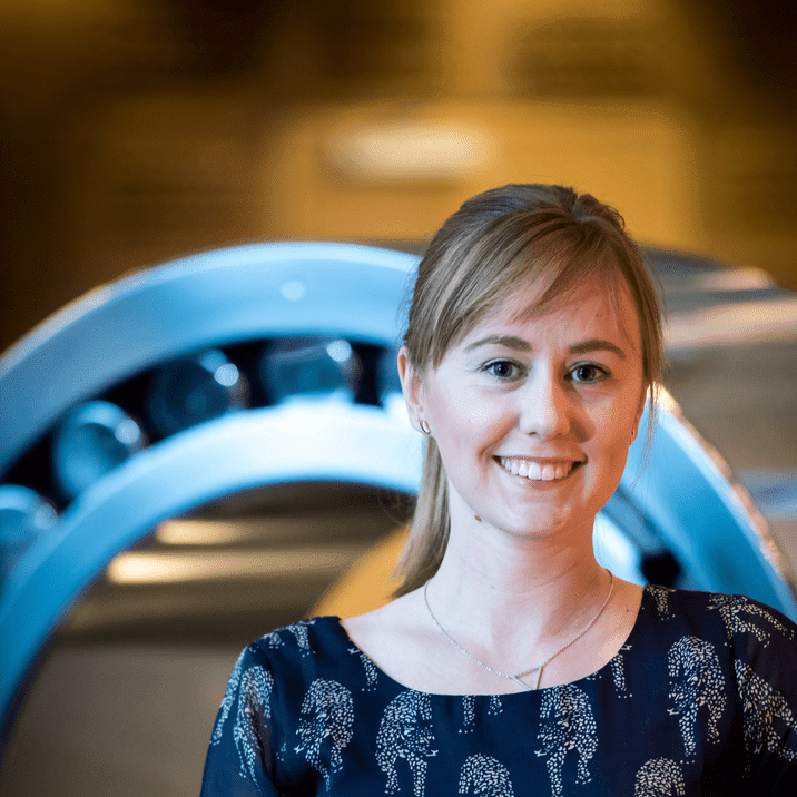 Trainee Sophie Sundberg stands in front of a large bearing